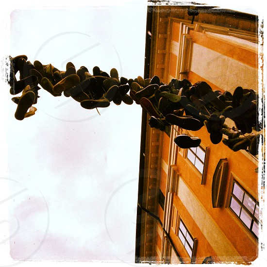 Shoes in the sky slovenian street scene photo