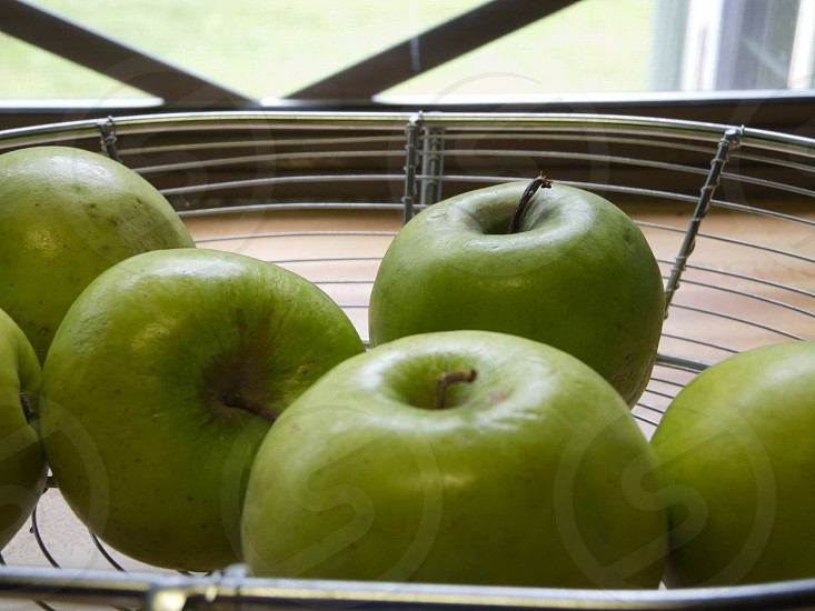 green apple on stainless fruit tray photo