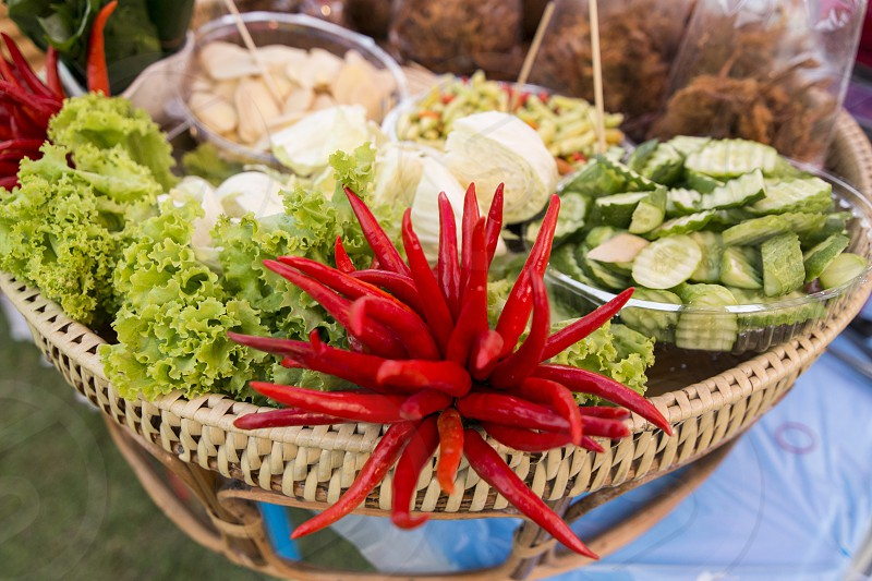 spicy food at the traditional food market at the Phimai festival in the Town of Phimai in the Provinz Nakhon Ratchasima in Isan in Thailand.  Thailand Phimai November 2017 photo