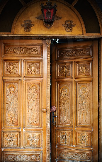 Orthodox church in Greece details of big wooden ornamented doors. photo