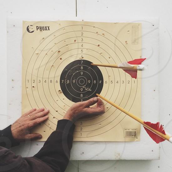 two arrows on target board photo