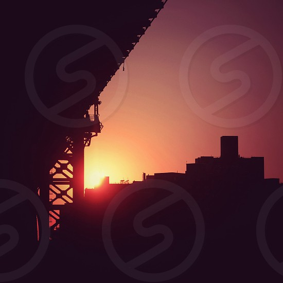 A hint of sunshine hidden by the bridge. New York NY. photo