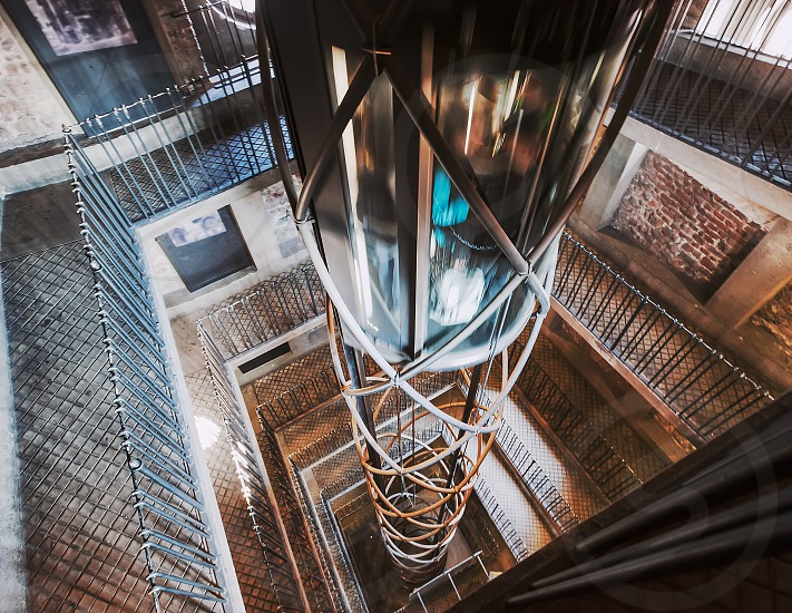 Old vintage european elevator moving up in Prague old town square building photo