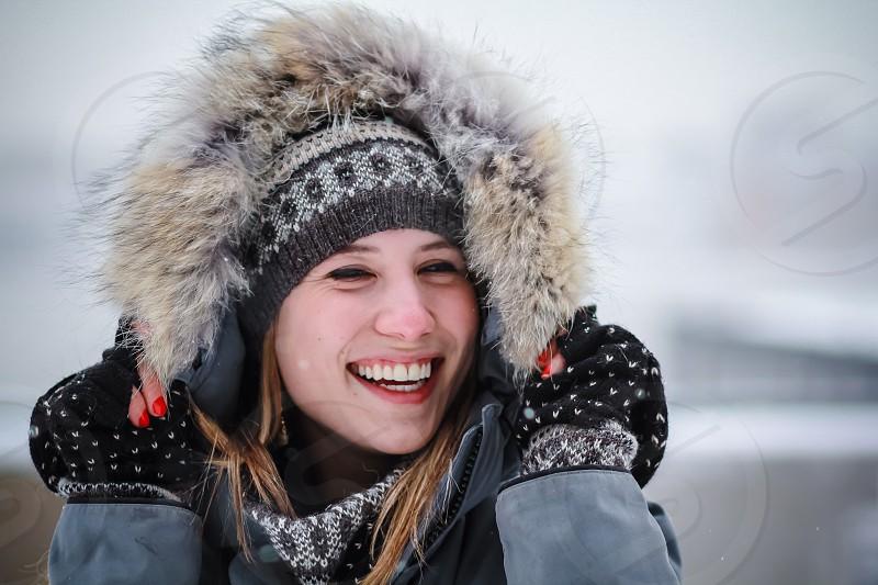 Pretty Young Girl in Fun Winter Scene photo