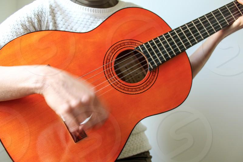 Lady playing guitar photo