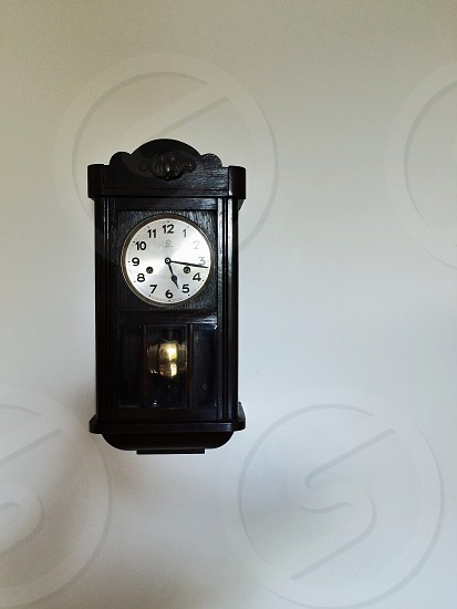 black and white face analog wall clock photo