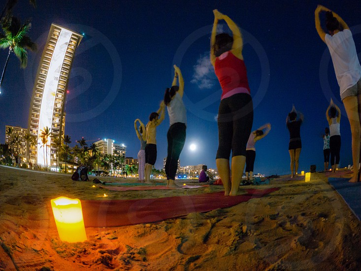 Waikiki beach full moon yoga group Hawaii  photo