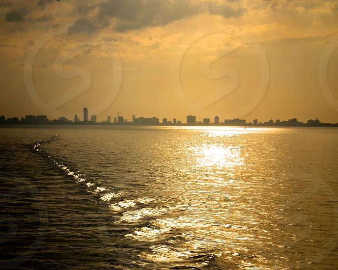 city skyline across body of water photo