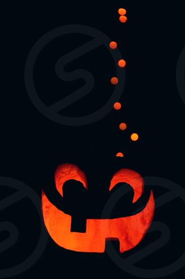 A Halloween jack-o-lantern at night. photo