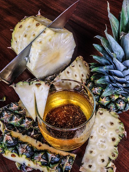 Cut up pineapple with summer libation photo
