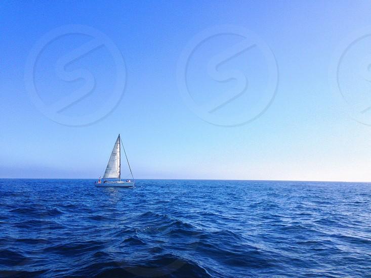 white sailing boat on sea photo
