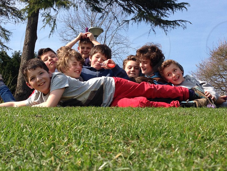 I selected this image from my stock because  of its significance to the brief. The child laying across the group is my son. He has ADHD and severe learning difficulties. The kids behind him are his healthy and very loyal friends who have known him since he was a baby. Although the differences between my son and the group are becoming more and more obvious as they grow up together the group help and support my son everyday but mostly they still have friendship.  photo