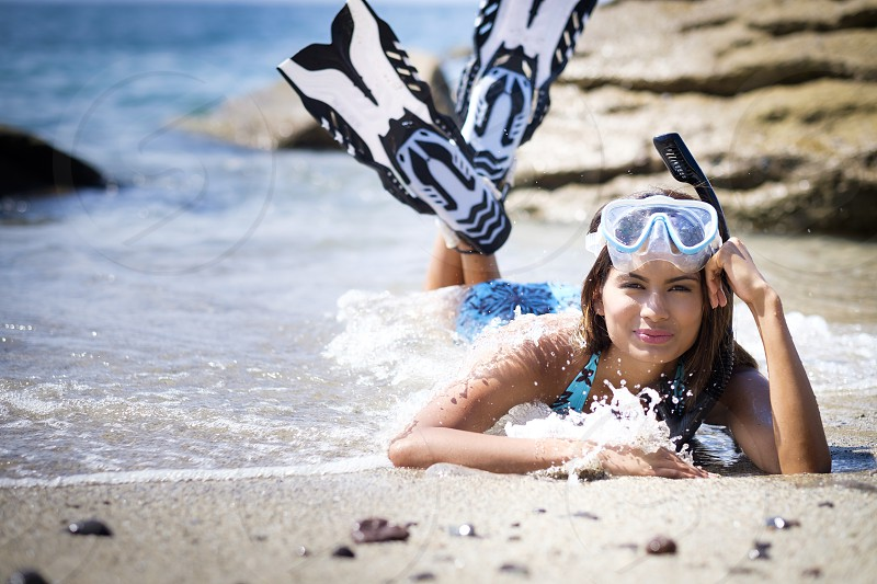 Young woman in snorkeling gear enjoying a vacation day at the beach in Mexico. photo