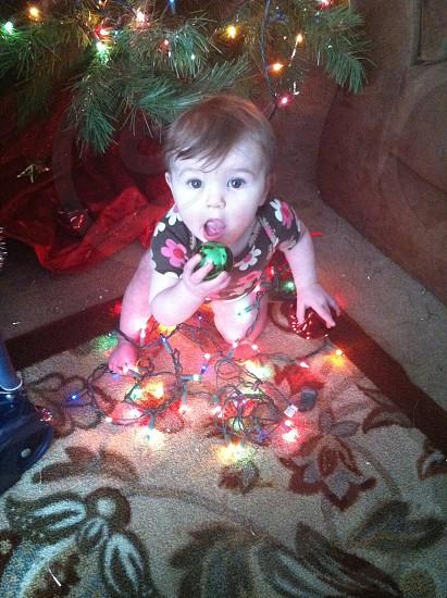 Baby girl Christmas lights photo