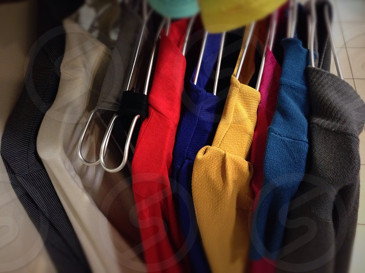 assorted-color of clothes in clothes hanger photo