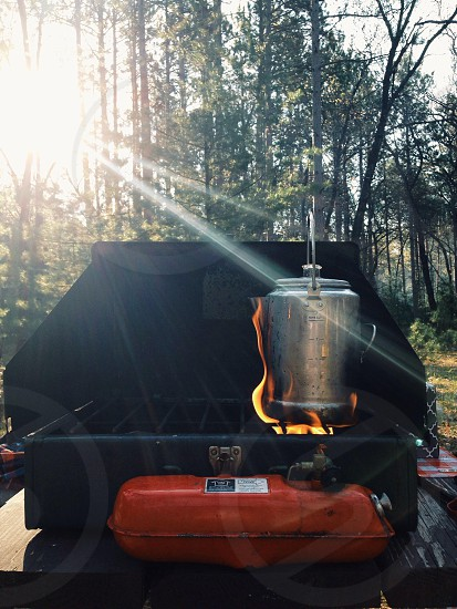 stainless steel container on top of black grill photo