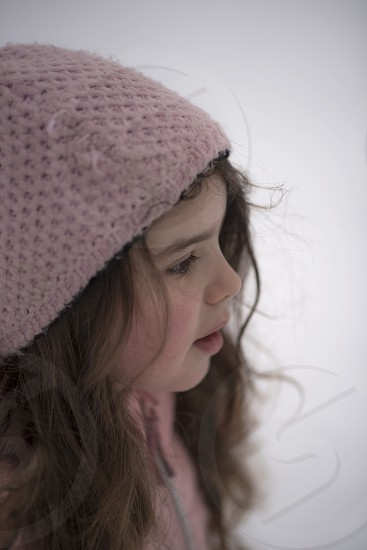 Portrait of a young girl out playing in the winter landscape photo