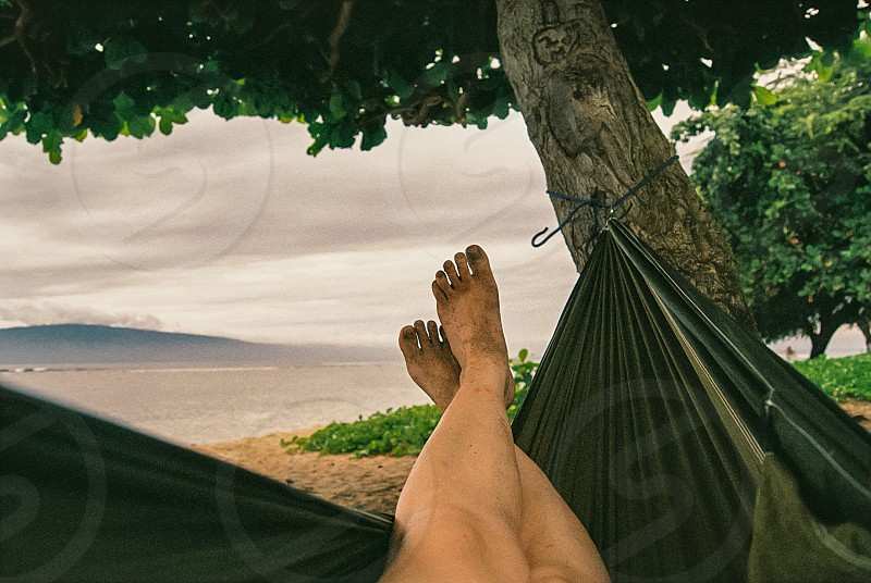 Relaxing in a hammock in Hawaii shot on film. Higher resolution available on request. photo