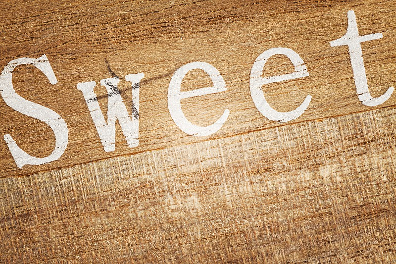 Word Sweet printed on a wooden plank.  photo