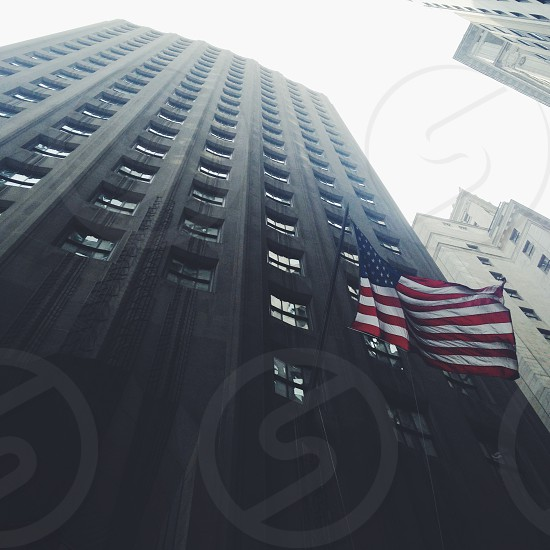 usa flag near highrise building low view photography  photo