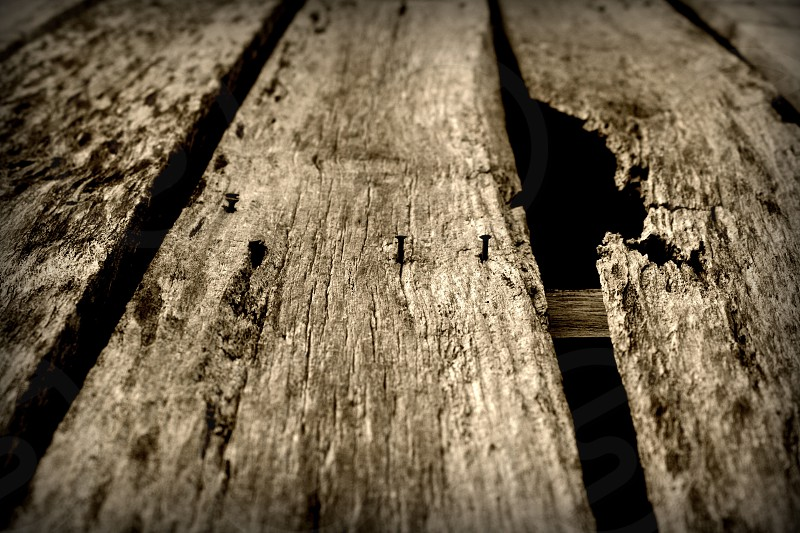 """""""Knot"""" A few pieces of old wood give a barn some character. photo"""