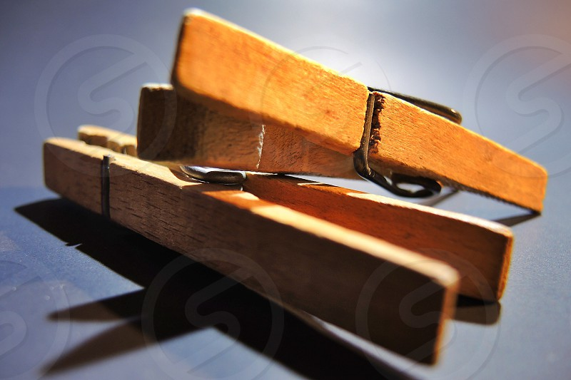 2 brown wooden clothespin photo