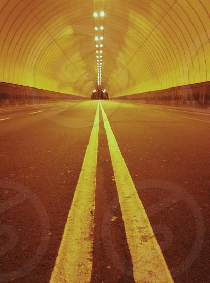 Yellow lit road tunnel photo