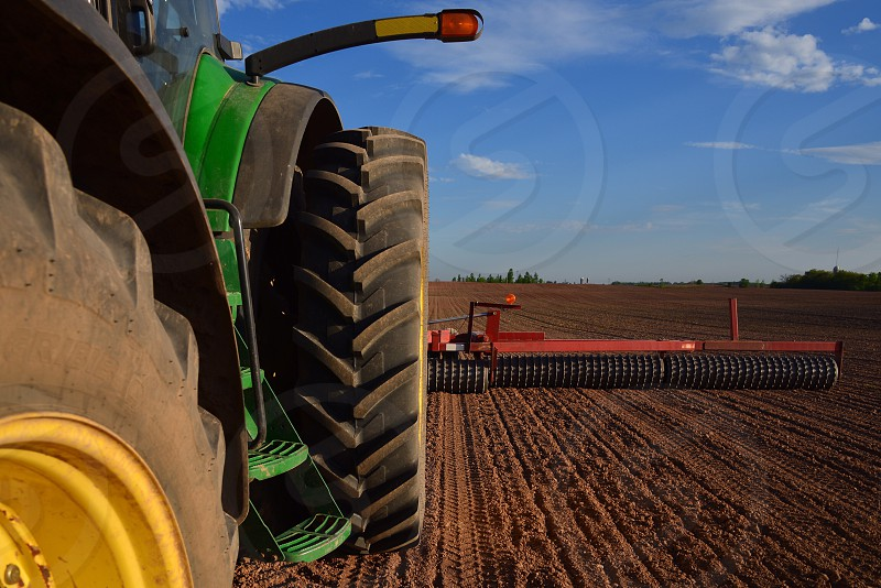 Modern Agricultural Equipment in a Farm Field Preparing a Seed Bed for Spring Planting photo