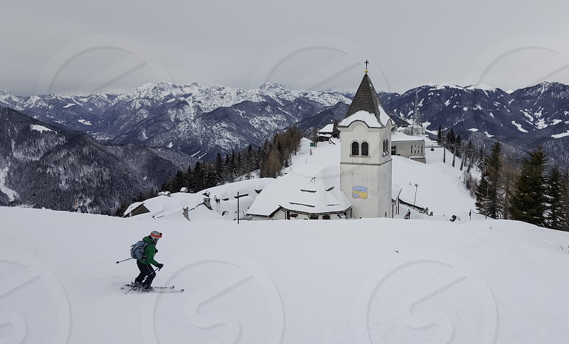 Single skier in the mountains. photo