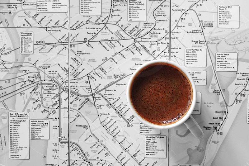full white ceramic mug on white black gray map page photo