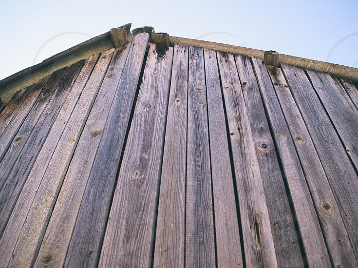 Wooden Shack Roof with Blue Sky Closeup photo
