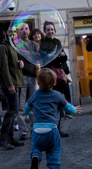 Child playing with soap balls Prague photo