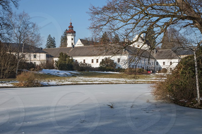 General view of the castle Velke Losiny with a frozen pond in the park (Czech Republic) photo