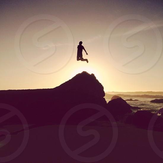 man jumping silhouette  photo