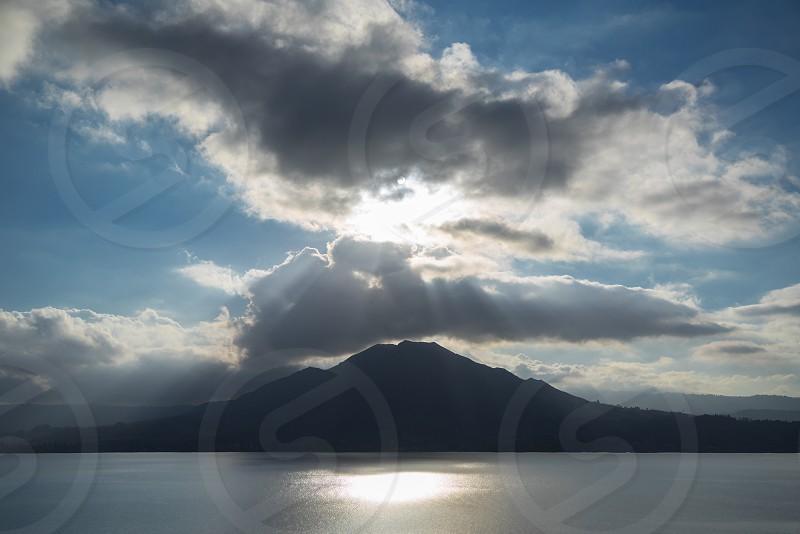 mount batur; lake batur; bali; indonesia; ray of lights photo