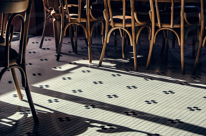 Wooden chairs on a French tile floor. photo