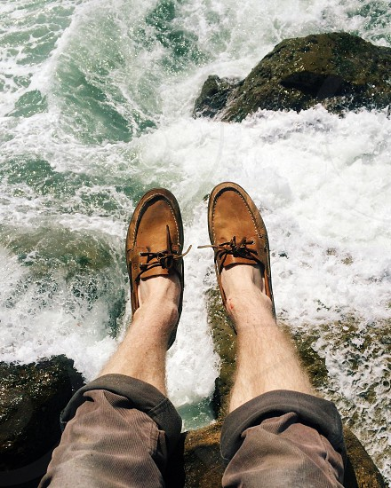 person in brown boat shoes photo