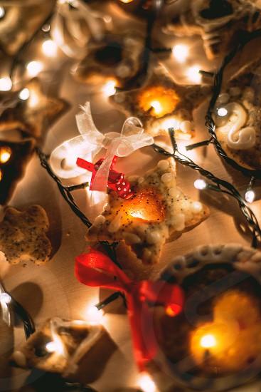 christmas holiday festive seasonal close up baules lights reflection bow gingerbread cookies photo