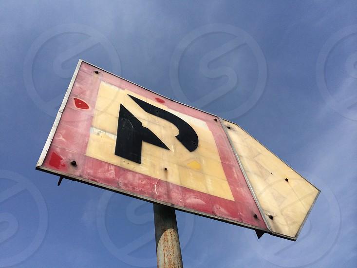 black p road sign photo