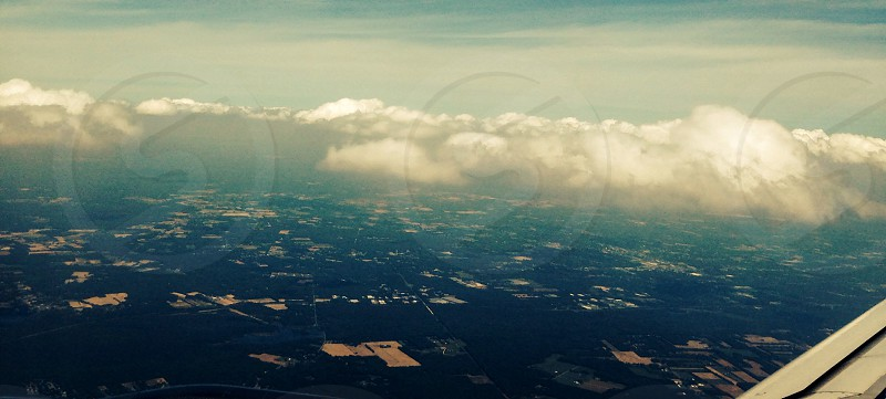 Sky airplane travel blue sky's clouds America details dots homes above photo