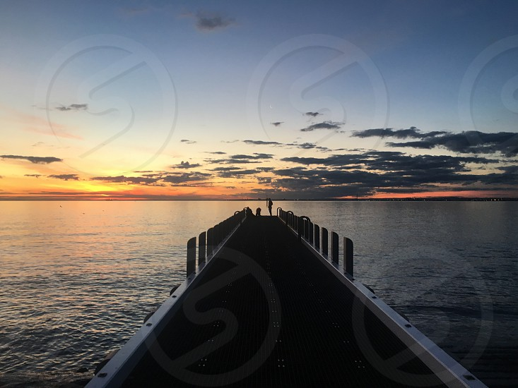 Beach pier sunset idyllic Jetty sea water dusk calm serene Australia Brighton Beach orange vibrant silhouette orange evening copy space distant vanishing point outside daytime clouds Sky  photo