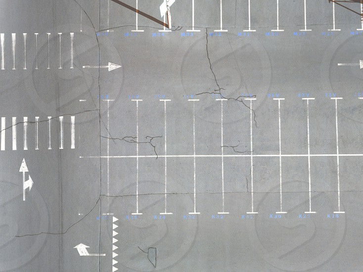 Aerial view of an empty parking lot with a lot of places sunny day. Top view photo