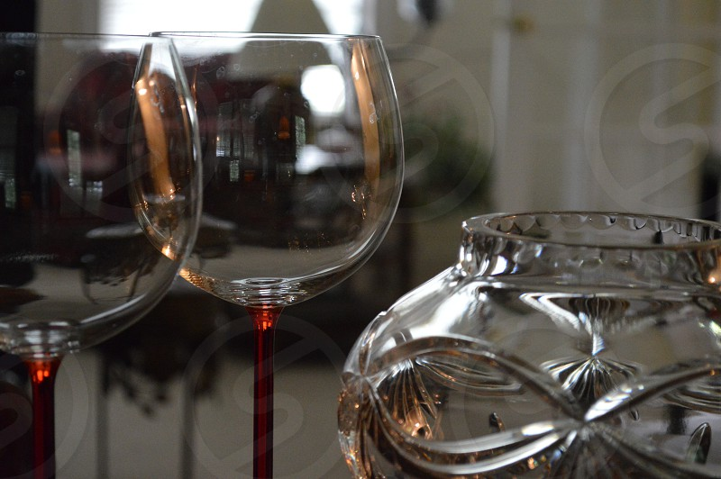 wine glasses beside glass jar photo