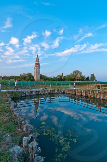 "Venice Burano Mazorbo vineyard with ""campanile"" belltower of Saint Caterina on background photo"