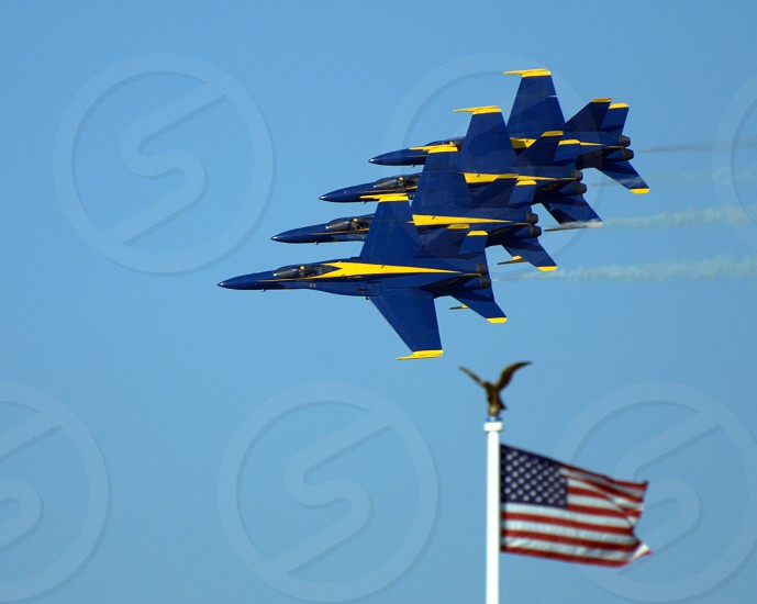 The blue angels jets over american flag photo
