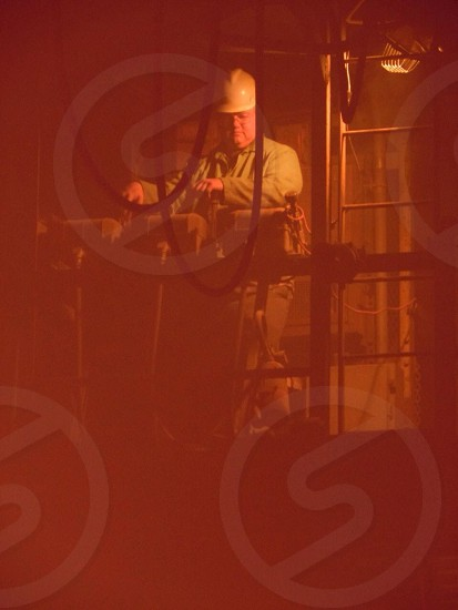 person wearing hard hat controlling equipment photo