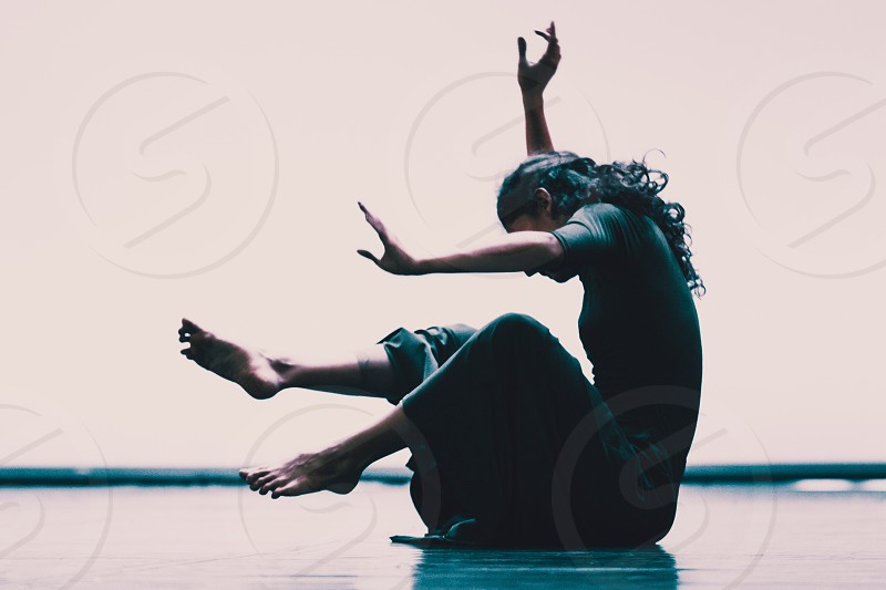 Young Woman Dancer On The Floor photo