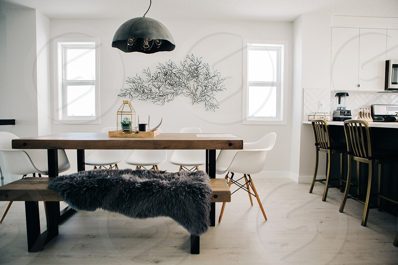 scandinavian dining room dining chairs dining table light fixture white light modern earth tones earthy table windows house homey minimalist minimalism photo