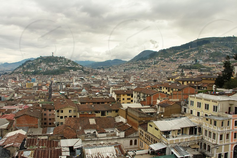 Cityscape of Quito Ecuador and its surrounding mountains. photo