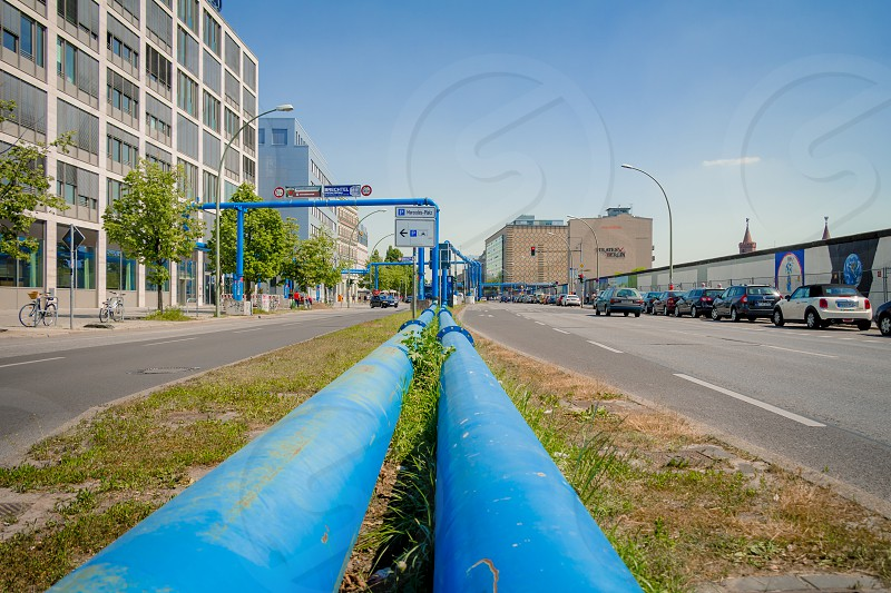 Berlin Germany - May 19 2017: Blue pipes at the street of Berlin city. The pipes are used to pump water away from construction sites due to the city's high groundwater level. photo
